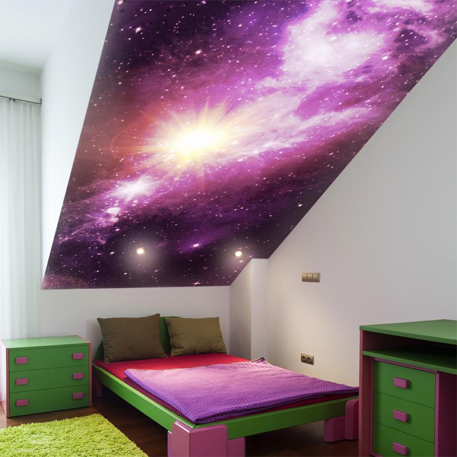 Sypialnia dla dziecka na poddaszu - fototapeta galaktyka